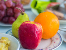 Talerz jabłko, pomarańcze i bonkreta, Zdjęcie Stock