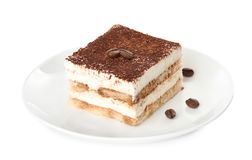 Talerz tiramisu tort na bielu zdjęcie royalty free