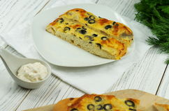 Talian food - traditional focaccia with mushrooms and olives. On wooden background, top view Royalty Free Stock Image