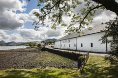 Talisker distillery at Carbost on Skye. Famous Talisker distillery in Carbost on Isle of Skye in Scotland royalty free stock image