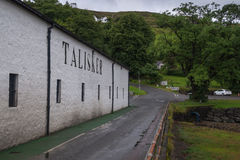 Talisker Distillery, Isle of Skye, Scotland. The warehouse of Talisker Whisky Distillery, Carbost, Isle of Skye, Scotland producing single malt scotch whisky stock images