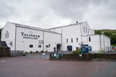 Talisker Distillery, Isle of Skye, Scotland. Talisker Whisky Distillery, Carbost, Isle of Skye, Scotland producing single malt scotch whisky. Part of the Diageo royalty free stock images