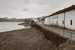 Talisker Distillery, Skye. CARBOST, SCOTLAND - APRIL 17: Talisker Distillery, the only whisky distillery on the Isle of Skye, on April 17, 2012 in Carbost royalty free stock photography