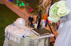 Talit, book, roses, red wine at a wedding Stock Photography