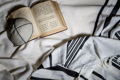 Talit, Kippah and Siddur - Jewish ritual objects. Jewish ritual objects, elements of prayer vestments, Talit, Kippah and Siddur - jewish prayer book with english Stock Photo