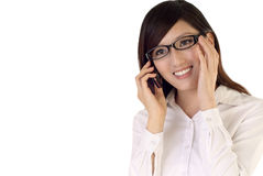Talk. Business woman talk to cellphone with smiling face on white background Royalty Free Stock Images