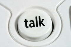 Talk. Close up to a cordless telephone talk button Royalty Free Stock Photography