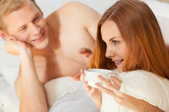 Talk in bed. Pair talk in bed on lazy morning Royalty Free Stock Image