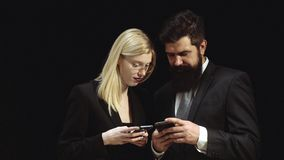 Talk with friends. Friendly concept - smiling bearded man and blonde woman at meeting. Browsing Internet texting and stock video footage