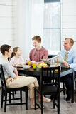 Talk by kitchen table Royalty Free Stock Photography