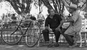 A Talk Between Men. Two men having a talk in the park in Valladolid, Mexico Royalty Free Stock Image