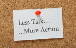 Less Talk More Action. The phrase Less Talk, More Action on a cork notice board as the motivation to getting things done at work or at home Royalty Free Stock Photo