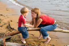 Talk at sea. Mom and the son talk at the sea.Evening Stock Image