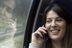 Talk with a Smart Phone on the Train Royalty Free Stock Images