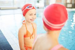 Talk by swimming-pool Stock Photo