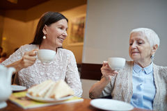 Talk by tea Royalty Free Stock Image
