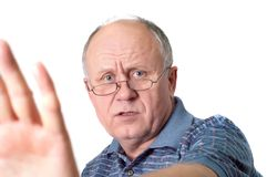 Talk to hand. Bald senior man's gesture talk to the hand. Isolated on white Royalty Free Stock Photo
