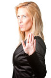 Talk to the Hand. Blond businesswoman shows palm of the hand meaning she's not listening to what's being said Royalty Free Stock Images