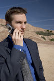 Talk to me. Man on cell phone in desert Stock Photo