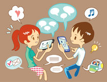 Talk to technology. A young couple enjoy their time, using a mobile and a tablet computer Royalty Free Stock Photo