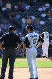 Talk to the ump. Colorado Rockies first basemen Todd Helton having short conversation with an umpire stock photos