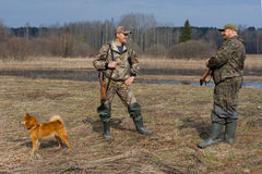 Talk of two hunters. On the field Royalty Free Stock Images