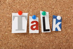 Talk. The word Talk in cut out magazine letters pinned to a cork notice board. Talking is an important part of bridging the gap in our professional and personal Royalty Free Stock Images