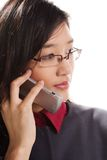 Talkative. Beautiful Asian girl talks on mobile phone stock images