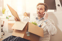 Talkative young man informing about his dismissal Stock Image