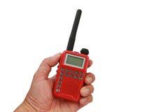 Talkie-walkie rouge tenu dans la main Images libres de droits