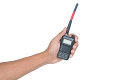 Talkie-walkie tenu dans la main d'isolement sur le fond blanc avec le clippi Photos stock
