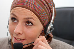 Talking. Muslim woman talking on headphones Stock Image