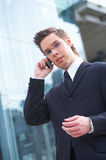 Talking. Businessman talking on his mobile phone Stock Images