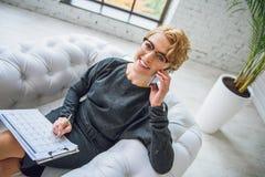 Talking advisor smiling at camera Stock Image
