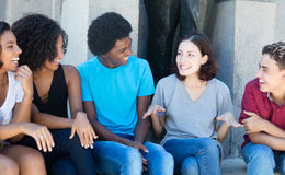 Talking african american and latin and caucasian people. Outdoor in the summer Stock Photography
