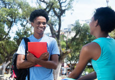 Talking african american male and female student on campus of un Royalty Free Stock Photography