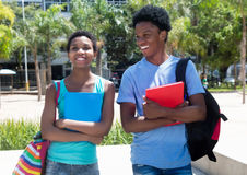 Talking african american male and female student on campus of un Stock Images