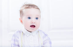 Talking baby girl with beautiful blue eyes Stock Image