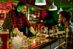 Talking in bar Royalty Free Stock Photo