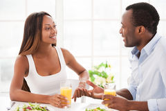 Talking at the breakfast table. Stock Image
