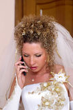 Talking bride. Young happy bride talking by the cell-phone Royalty Free Stock Photo