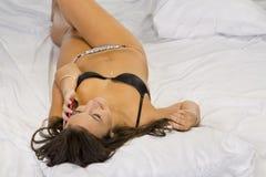 Talking Brunette Model in Lingerie Stock Photo