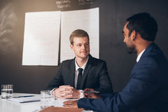 Talking business in the boardroom Royalty Free Stock Photos