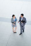 Talking business couple Stock Photography