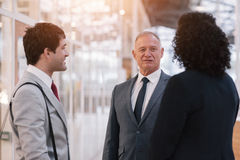 Talking business in the office lobby Royalty Free Stock Photo
