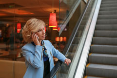 Talking business over the phone Stock Image