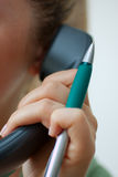 Talking on the business telephone Royalty Free Stock Photo