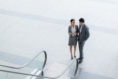 Talking businessman and businesswoman Royalty Free Stock Image