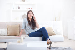 Talking call whilst on sofa Stock Images