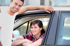 Talking through car window Stock Images